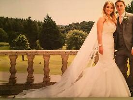 Wedding Dress size 8-10. Worn once. Art couture/Pronovias. Can deliver