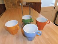 A set of 4 NEW Coffee Mugs in Chrome Holder