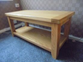 solid oak coffee table, very heavy and chunky good condition.
