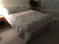 Double divan bed with mattress and storage drawers
