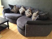 Black curved sofa