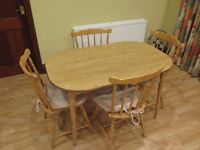 Pine Effect Kitchen Table and 4 Chairs in very good condition