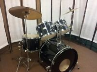 Retired Drum teacher has a Pearl Forum 'Fusion' drum kit with a choice of cymbals for sale.