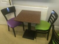 13 Tables (Granite and Timber) with black cast bases suitable for cafe or restaurant