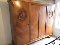 A beautiful ornate 4 door armoire wardrobe