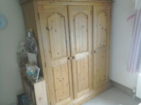 Solid antique pine triple wardrobe in good condition.