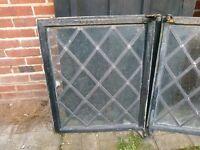 metal window frames with opening windows.leaded diamond pattern glass.