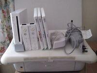 Nintendo Wii board, console, TV sensor bar, 2 remotes, charging dock, Wii Fit, Games, manuals