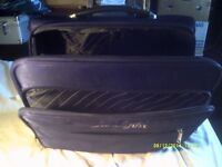 A SORT of SPORTS SUITCASE WITH SEVERAL COMPARTMENTS ALL ZIPS & HANDLES GOOD +++++