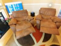 2 in number reclining lounge armchairs in brown
