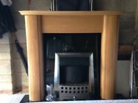 Wood fire surround with granite and electric coal effect fire complete