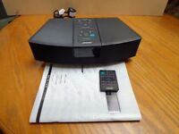 BOSE WAVE RADIO With remote and manual 2 available.