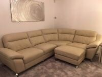 Cream Leather Corner Sofa and footstool less than 2 years old very good condition