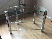 Glass and chrome corner tv stand.