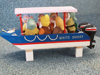 """White Dwarf a 15"""" long fun boat complete with crew and twin outboards, fully rc with bow light"""