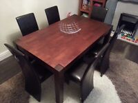 Solid wood dark oak dining table . 150 cm long / 90 cm wide / 75 high .