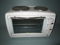 Igenix Table-Top Oven , With Two Hobs On Top . Used . In Working Condition . I Want A Quick Sale .