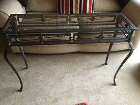 """Dunelm hall table diecast metal bronze antique style with a glass insert size 43"""" long x 29.5""""high."""