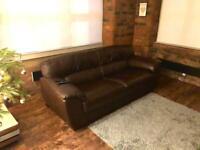 Chocolate brown leather sofa.