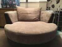 Brown swivel comfy chair from DFS.