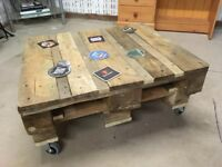 Wooden pallet coffee table on castor wheels