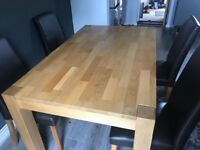 Solid pine dining table and 4 x brown leather chairs