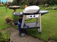 Outback Gas Barbeque with gas bottle and lavarock and cover
