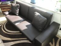 Sofa. Studio Couch. Converts into a day bed. New Condition.