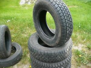 four 215-75-15 tires $100.00