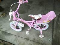 Girls 12 inch bike and helmet