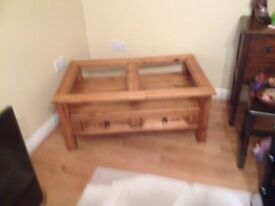 Coffee table with glass top and two draws