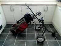 Set of Pinseeker golf clubs, bag, trolley and accessories