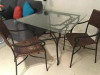 Glass and metal dining table with 4 chairs