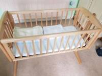 Swinging crib with mattress/ sheets and blankets