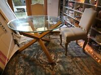 Round glass table with oak legs.