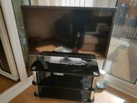 Panasonic 37in tv and glass stand