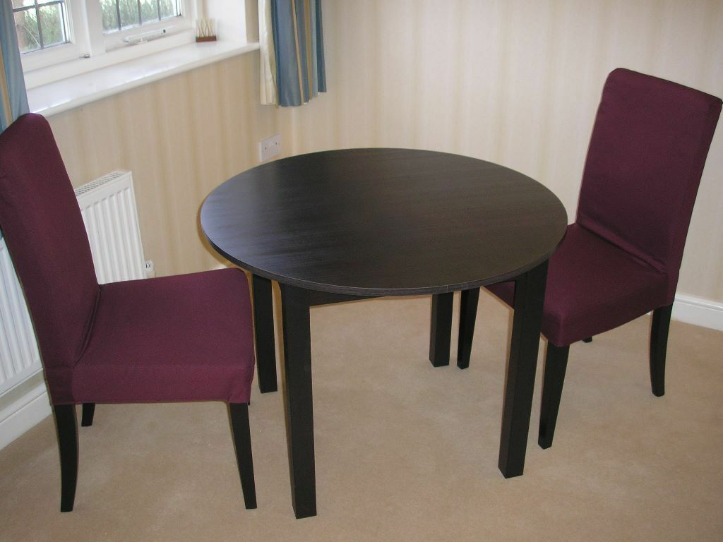 Reduced Kea Round Dark Wood Table With Two Ikea Chairs