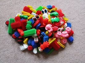 Bag of stickle bricks. 173 items including wheels, hats, faces and elephant