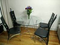 Round Glass Dining Table & Chairs