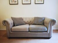 Small grey Chesterfield sofa