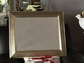 Mirror with gold/brown hammered finish