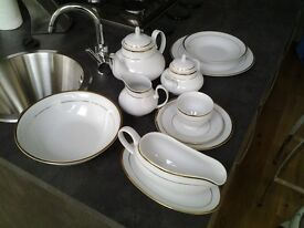 Beautiful White and Gold dinner set for 12 people