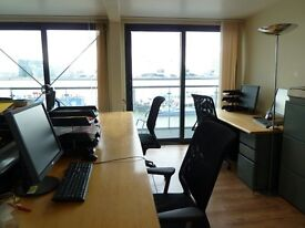 Deskspaces available in quiet architects studio with fabulous views over Thames in Docklands