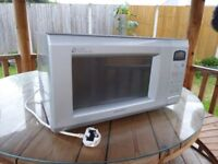 A C.R.S. microwave oven, although the light does not light the oven is in full working order.