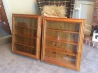 Two glass display cabinets