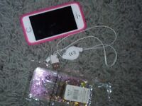 I phone 5. Good as new iPhone 5. Has charger,pink cover and also New dreamcatcher glitter cover.