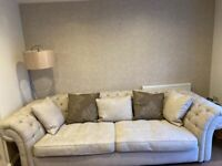 Fabric Chesterfield style sofa and snuggle chair