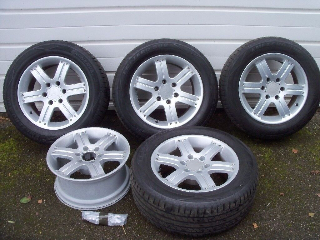 Mitsubishi 4x4 alloy wheels with 225/55 r18 road tyres, set of four with spare alloy wheel.