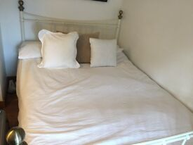 Double bed, metal frame with unused mattress