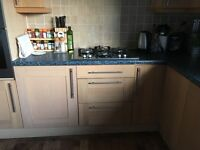Oak Kitchen with worktop, hob, cooker hood and Bosch double oven